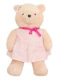 Teddy Bear In Pink Dress poner crema Fotografía de archivo libre de regalías