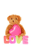 Teddy bear with pink heart Stock Image