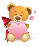 Teddy bear with pink heart Royalty Free Stock Photos