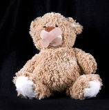 Teddy bear with plaster on mouth Royalty Free Stock Photography