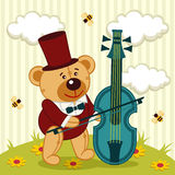 Teddy bear playing on cello Stock Images