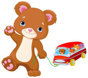 Teddy Bear Plays Toy Bus Illustrazione di Stock