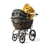 Teddy Bear in Pram II. Soft fluffy teddy bear looking back and waving while sitting in a vintage style pram/stroller. Copy space. DESIGN IDEA! Potential of stock photo
