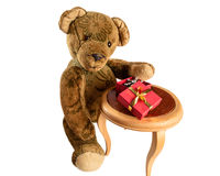 Teddy Bear presenting a Valentine´s Gift. NThe writing on the box is in german language and means: A gift from the heart Stock Images