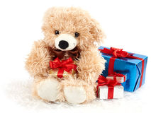 Teddy bear with presents isolated on white Stock Photos