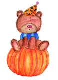 Teddy bear on pumpkin Royalty Free Stock Photos