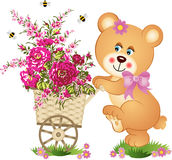Teddy bear pushing a cart of flowers Royalty Free Stock Photos