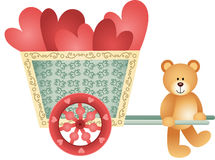 Teddy bear pushing a cart of hearts Royalty Free Stock Image