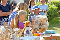 Teddy bear raffle prize winner. Photo of a young girl collecting her teddy bear prize at a garden fete in faversham on 7th sept 2013 Royalty Free Stock Image