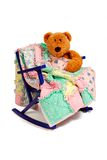 Teddy Bear Rag Quilt. A Teddy Bear sits in a vintage child's rocking chair, comforted with a rag quilt Stock Photos