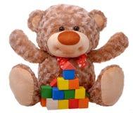 Teddy bear raising arms with tower Stock Photo