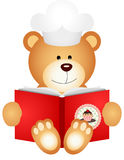 Teddy bear reading cookbook Stock Images