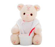 Teddy bear ready to eat. Flower teddy bear wearing a white bib and putting a red spoon into a white bowl, isolated on white.  Part of series featuring the same Royalty Free Stock Photos