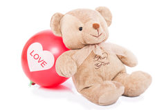 Teddy bear with red balloon Stock Photo