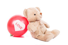 Teddy bear with red balloon Stock Photography