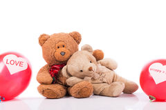 Teddy bear with red balloon Stock Images