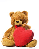 Teddy bear and red heart Royalty Free Stock Images