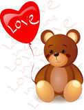 Teddy bear and a red heart Stock Photos