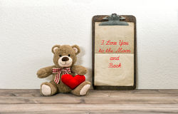 Teddy Bear with red heart and clipboard. Valentines Day concept Stock Photography