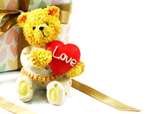 Teddy bear with red heart and gift box present Stock Image