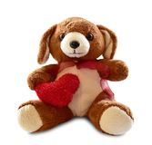 Teddy bear with red heart isolated on white background Stock Photos