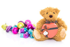 Teddy bear with Red heart shaped gift box Stock Photo