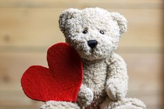 Teddy Bear with red heart royalty free stock photos