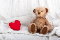 Teddy bear and red heart royalty free stock photography