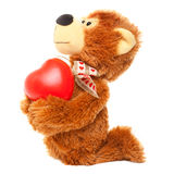 Teddy bear with red heart on white Royalty Free Stock Photo