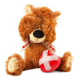 Teddy bear with red heart on white Stock Photo