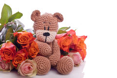 Teddy bear with red roses Royalty Free Stock Images