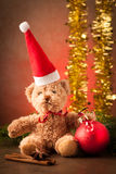 Teddy bear with red santa claus hat and christmas presents Royalty Free Stock Photo