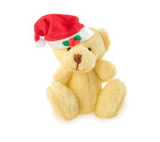 Teddy bear with red Santa hat on white. Royalty Free Stock Photo