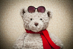 Teddy bear in a red scarf Royalty Free Stock Photography