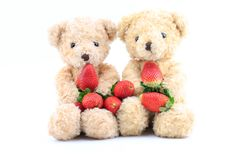 Teddy Bear and red strawberry behind the white background. Stock Photography