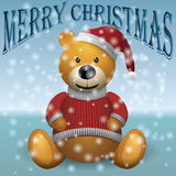 Teddy bear in red sweater red hat with snow text MerryChristmas.  Stock Images