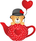 Teddy bear in red tea pot with heart balloon Stock Images