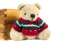 Teddy bear with red wool coat, on white Stock Image