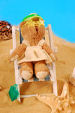 Teddy bear relaxing on the beach Stock Photography