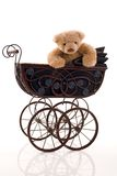 Teddy bear in the retro pram. Stock Image