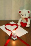 A Teddy bear. Ribbon in the shape of a heart Stock Photography