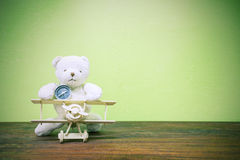 Teddy bear ride Wood airplane and compass ,on old wood  and gre Stock Photo