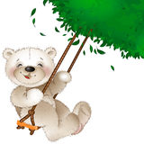 Teddy bear riding on a swing Royalty Free Stock Photography