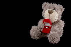 Teddy Bear with ring on black background Stock Photo