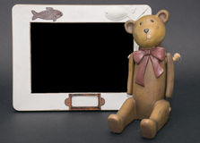 Teddy bear's blackboard. Teddy bear's near the blackboard were you can write anything Stock Photo