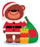 Teddy bear Santa Claus with Christmas gifts Stock Photo