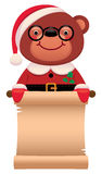 Teddy bear Santa Claus with a scroll Christmas Royalty Free Stock Images