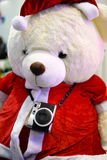 Teddy bear santa clause in christmas with camera Stock Photo