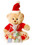 Teddy bear in santa hat Royalty Free Stock Images
