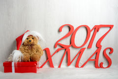 Teddy bear in santa hat with gifts Royalty Free Stock Photography